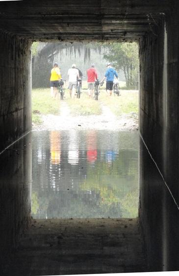 Expedition members cross underneath Interstate 4 in January