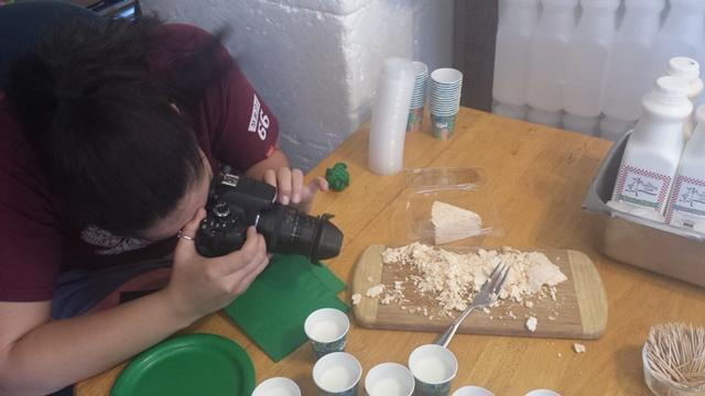USFSM hospitality management junior Tiffany Sabroso takes a picture of goat cheese at the Dancing Goat Farm