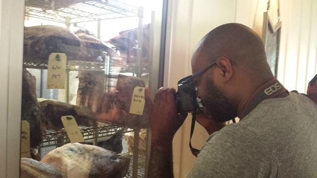 Vaughan sees what's in the meat refrigerator at Locale Market.
