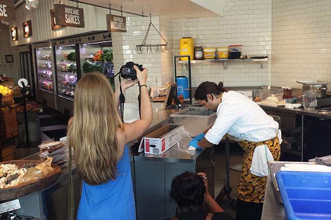 USFSP students Brigitte Toulon (left) and Anna Stebbins capture Locale Market chef Pedro Arreaza as he makes mozzarella cheese.