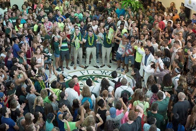 New and returning students stand around the USF seal in the Marshall Student Center at Thursday's kick-off pep rally.