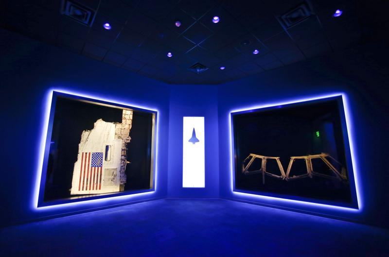 A side body panel of space shuttle Challenger, left, and the cockpit widows of Columbia, right, displayed at the Forever Remembered exhibit and memorial for the astronauts that perished on the two shuttles at the Kennedy Space Center Visitor Complex