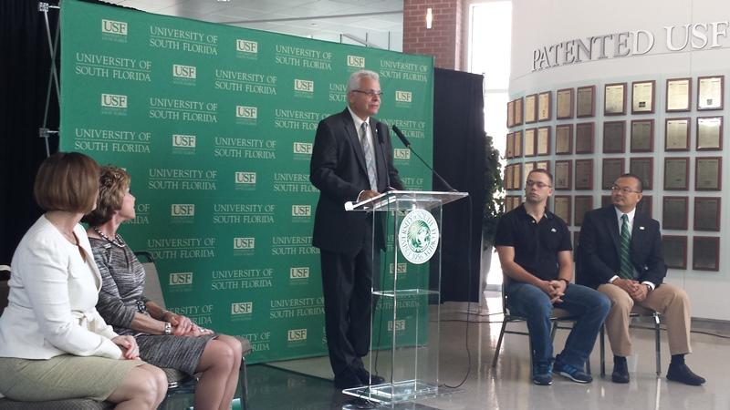 Dr. Paul Sanberg talks about USF's status as an I-Corps site as Rep. Kathy Castor, USF President Judy Genshaft and USF researchers Ismet Handžic and Dr. Daniel Yeh look on.