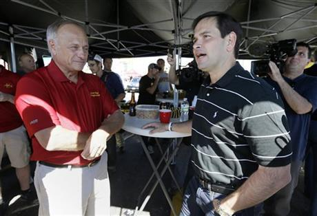 In this Sept. 12 file photo, Republican presidential candidate Sen. Marco Rubio, R-Fla., talks with Rep. Steve King, R-Iowa, left, during a tailgate party before an NCAA college football game between Iowa and Iowa State in Ames, Iowa.