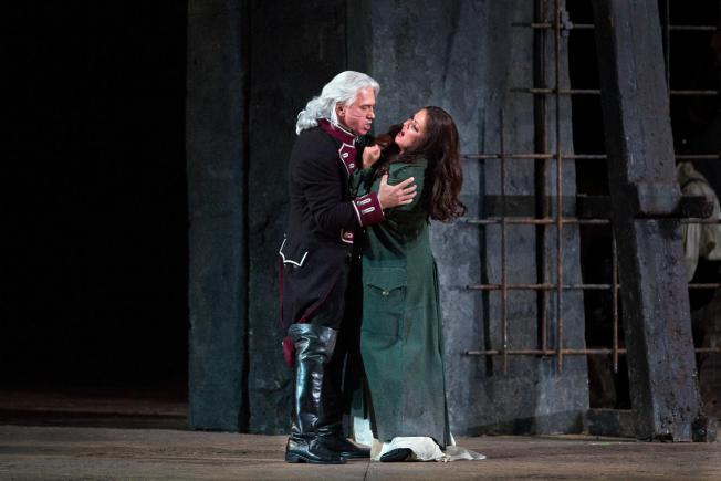 "Baritone Dmitri Hvorostovsky, left, and soprano Anna Netrebko, right, perform in a scene from ""Il Trovatore""."