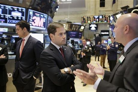 Sen. Marco Rubio, R-Fla., center, talks with specialist Jay Woods, right, during a visit to the New York Stock Exchange in New York, Monday, Oct. 5