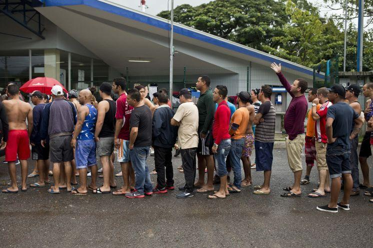 Cuban migrants line up for breakfast given to them by an evangelical church, Saturday outside of the border control building in Penas Blancas, Costa Rica, on the border with Nicaragua. Thousands of Cuban migrants have been able to make the trip to the U.S