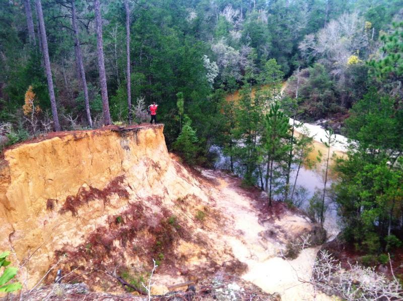 Expedition photographer Carlton Ward Jr. shoots the massive bluffs overlooking Juniper Creek