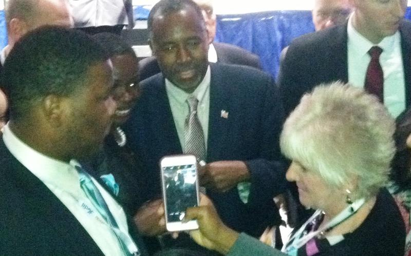 Candidate Ben Carson presses the flesh after his speech at the Sunshine Summit in Orlando