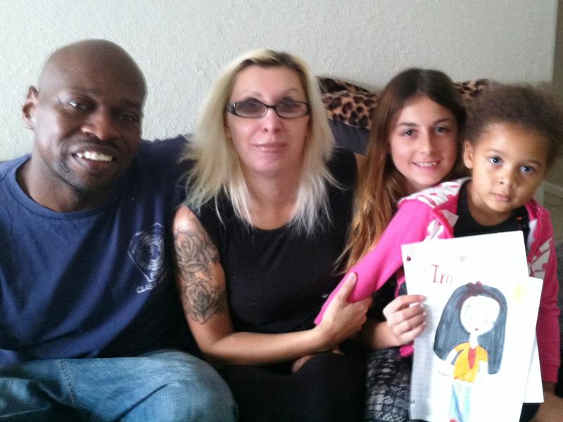 Transitioning Army veteran Keith Norman, his wife Lina Norman and two of their four daughters, Shelia Encheva, 12, and Kiara Norman, 3.