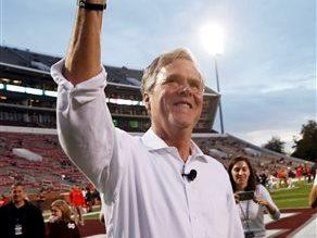 Jeb Bush, shakes a cowbell prior to pre game activities of an NCAA college football game between in state rivals Mississippi and Mississippi State in Starkville, Miss., Saturday, Nov. 28