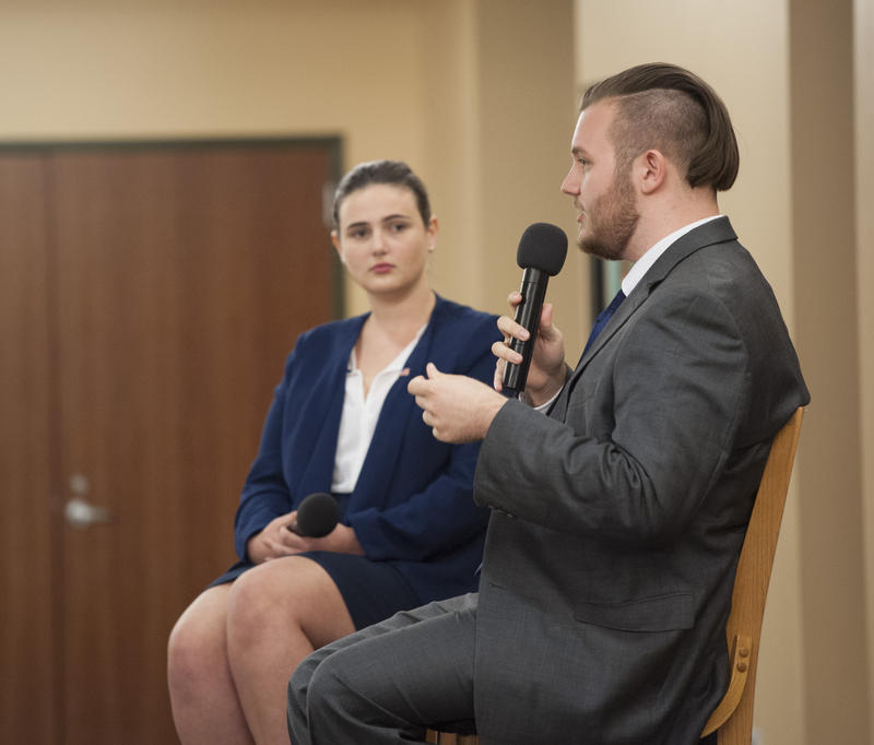 Emily Mincey of the GOP (left) and Jacob Gates on the Democratic ticket at last week's mock vice presidential debate at St. Leo University.