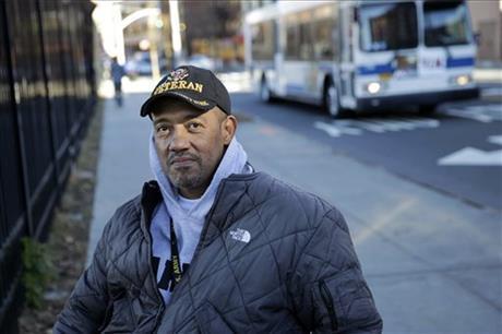 U.S. paralyzed Army veteran Gene Laureano sits in his wheelchair Wednesday, Dec. 16, 2015, in Bronx, N.Y.