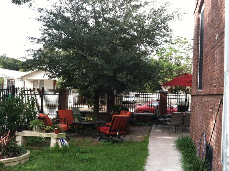 In addition to shared a shared living room, kitchen, laundry and bathroom, there's a large sitting area outside Athena House furnished by Home Depot volunteers including a garden in the side yard.
