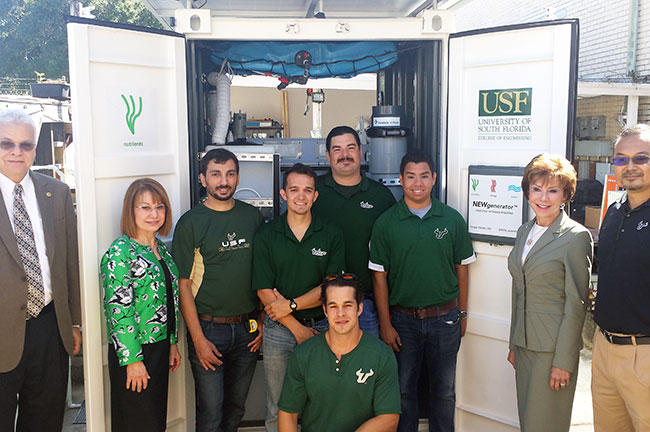 Dr. Daniel Yeh (far right) and his team of students pose in front of the NEWgenerator with USF executives in October 2015.