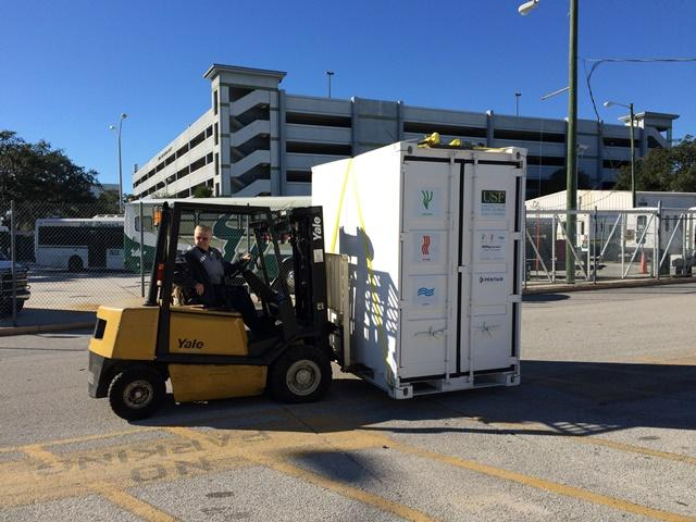 The NEWgenerator is moved from its site at USF to a shipping container.