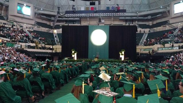 Students wait for the Friday evening commencement ceremony to start in the USF Sun Dome.