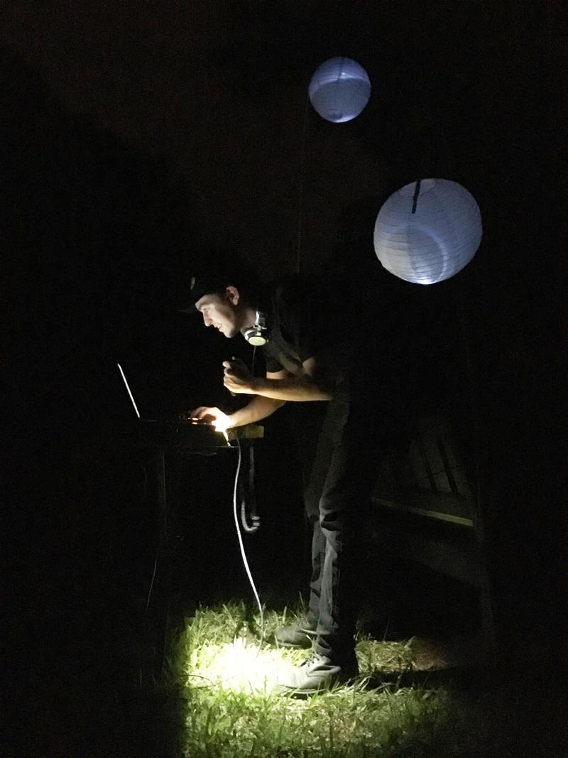 St. Petersburg artist jesse Vance checks his equipment before performing at a Boyd Hill Night Hike.