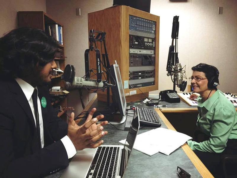 WUSF's Lisa Peakes, right, speaks with Anand Pallegar, Director of PINC USA.