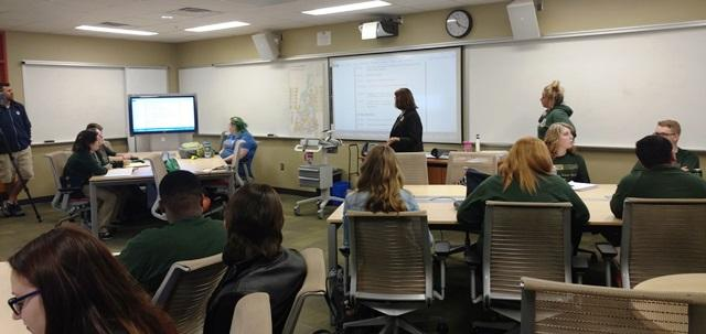 USFSP Prof. Judithanne Scourfield McLauchlan goes over the itinerary for the class' upcoming trip to New Hampshire.