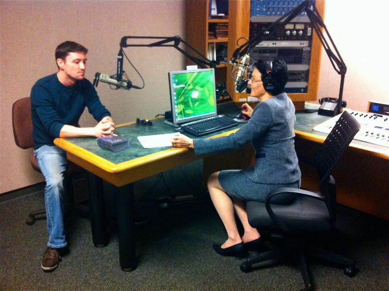 "Mel Walsh, the guitarist from Clearwater's ""Row Jomah"" in the WUSF newsroom studio with Lisa Peakes"