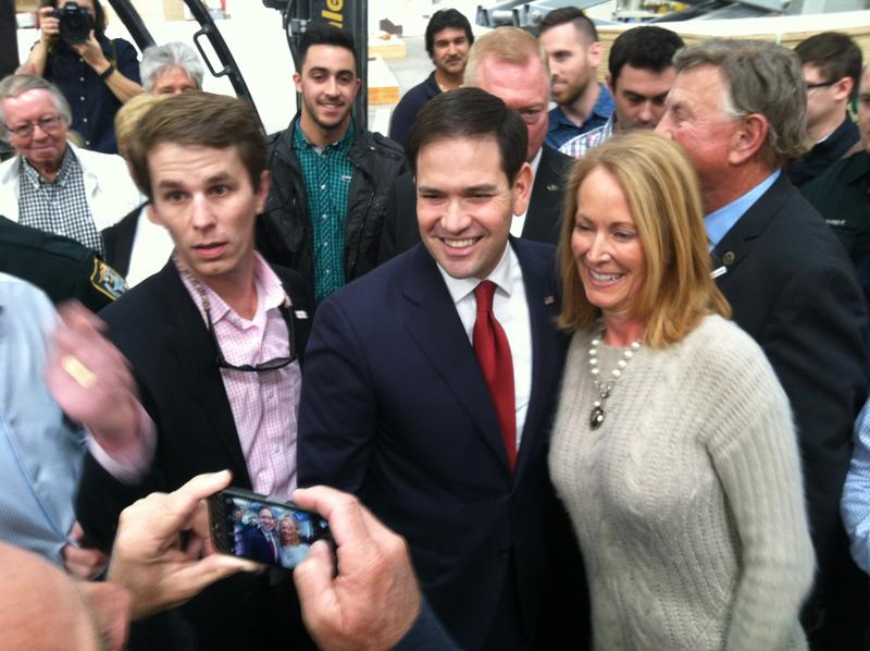 Sen. Marco Rubio poses with supporters after the event