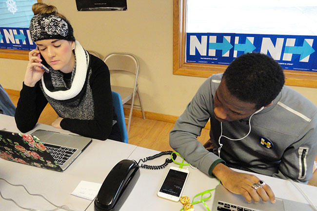 USF St. Petersburg students Kristina Sonstroem and Victor Sims work a phone bank in Salem, NH, for Hillary Clinton.