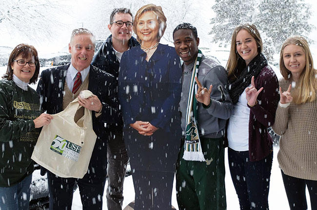 Students campaigning for Hillary Clinton convinced former Vermont Gov. Howard Dean to join them and a Hillary cardboard likeness for a picture in the snow.