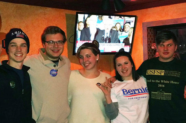 The students who backed Trump and Sanders pose for a victory photo at the class' Election Night watch party.