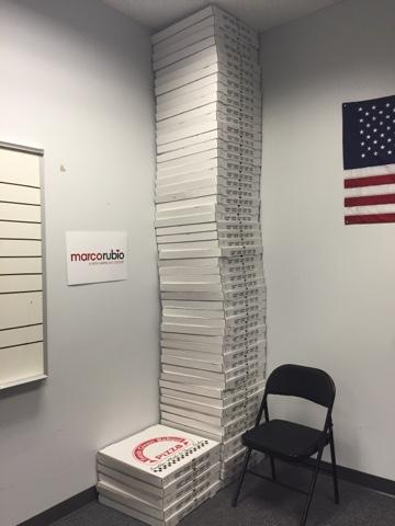 """A stack of empty pizza boxes - the staple of a campaign - at Rubio headquarters. Unnamed student: """"If I never see another slice of pizza again, I'd be happy."""""""
