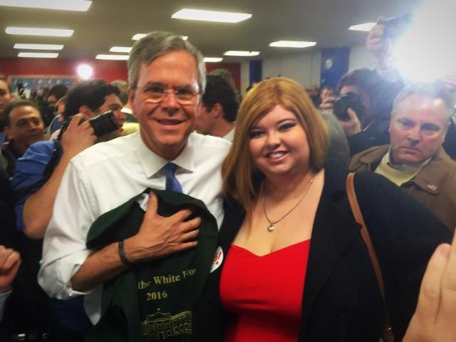 """Emily Hughes presents her candidate, Jeb Bush, with a class t-shirt. Hughes: """"I get a good vibe from Jeb and the more I talk to him, the more I feel comfortable in my vote for him."""""""