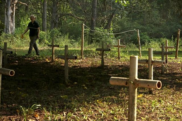 In a photo from August 2013, USF anthropology professor Erin Kimmerle walks through the Boot Hill cemetery at the Dozier School for Boys in Marianna, FL.