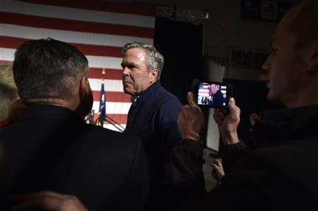 Republican presidential candidate Jeb Bush greets people during a campaign stop in Aiken, S.C., Tuesday