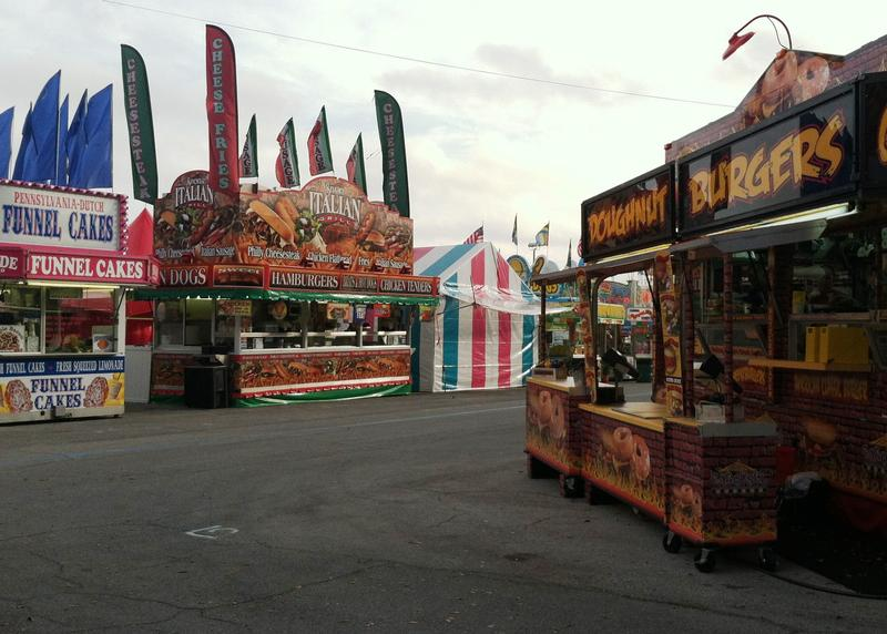 "A corner of the Florida State Fair midway where ""doughnut burgers"" meet ""funnel cake pizzas."""