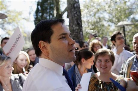 Republican presidential candidate, Sen. Marco Rubio, R-Fla. meets with attendees during a campaign stop, Tuesday in Summerville, S.C.