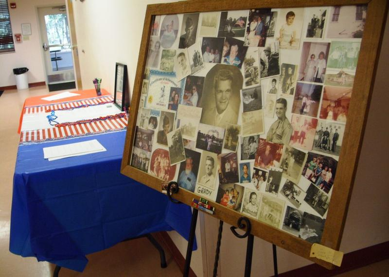 A display of photographs featuring Grady Halcomb from boyhood through his military career and family life.