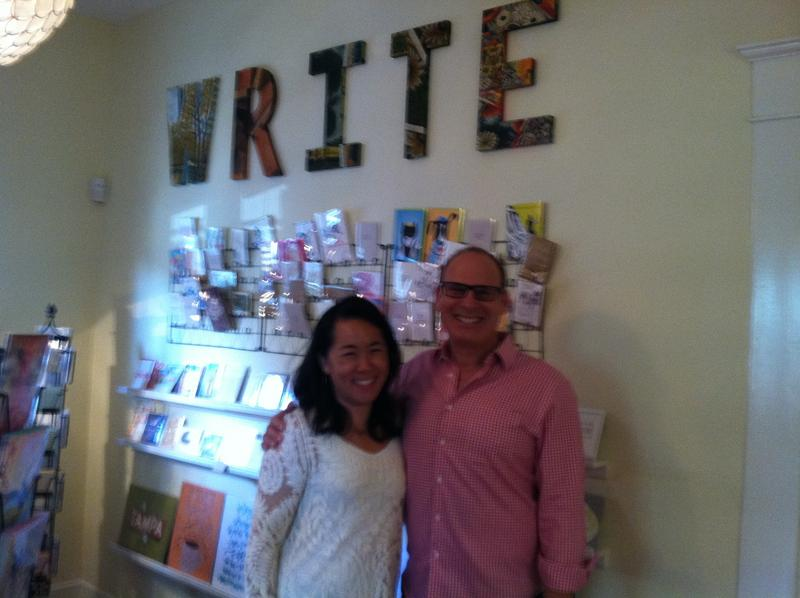 Tona Bell and her husband, Randy Rosenthal, in front of the handcrafted cards display at the Paper Seahorse.