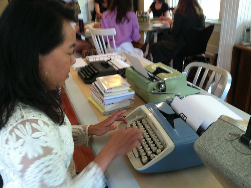 Owner Tona Bell demonstates her typing skills on a 1960s Royal typewriter set out for National Letter Writing Month participants.