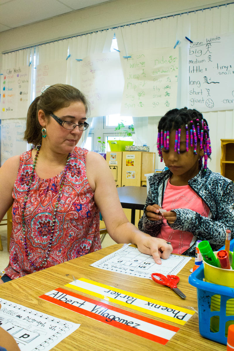 Nicole Backstrom and kindergartender Phoenix Parker work on a math worksheet. Nearly all of Mort Elementary's 800 students come from the surrounding community that is plagued by crime and poverty.
