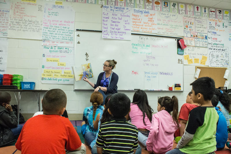 Kaitlyn Piccorelli captivates her first grad classroomn during reading time. Nearly half of Mort Elementary School students are hispanic.