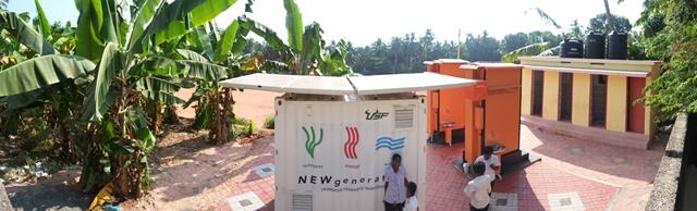 A panoramic photo of the NEWgenerator, the eToilets and the school