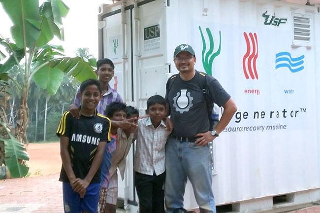 USF engineering associate professor Daniel Yeh with some children at a school in a fishing village in Trivandrum, the capital of the southern Indian state of Kerala.