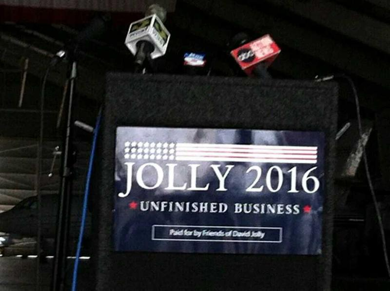 A sign on a podium at U.S. Rep. David Jolly's announcement in Clearwater makes clear his plans to run for re-election.