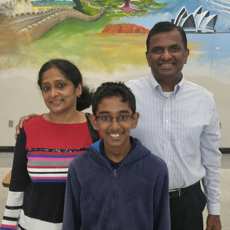 Rishi Nair's parents Geetha Muralidharan and Ray Murali celebrate at Williams Middle Magnet School