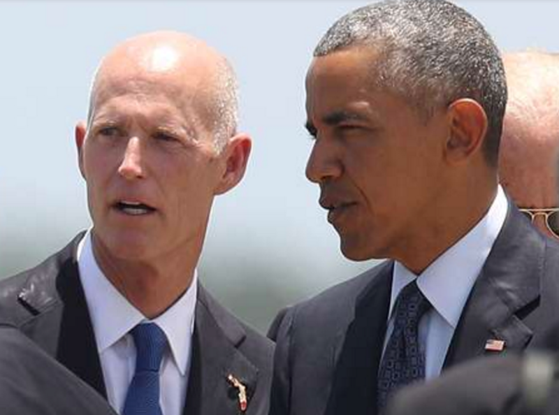 Florida Gov. Rick Scott greets President Barack Obama at the Orlando International Airport