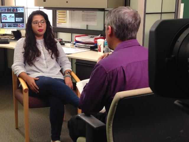 USF senior Mariana Sanchez Ramirez (left) talks with WUSF's Mark Schreiner before her trip to Cleveland for the Republican National Convention.