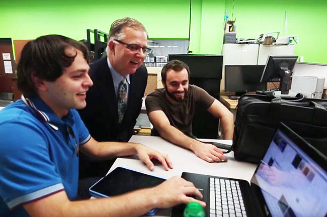 USF College of Engineering Dean, Dr. Robert Bishop (center) works with two students.
