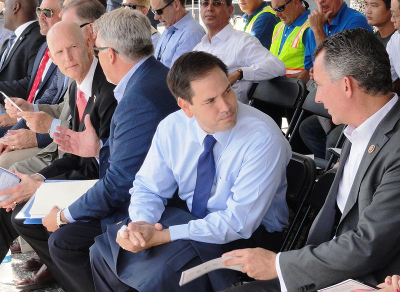 U.S. Sen. Marco Rubio, center, is flanked by Gov. Scott, left, and U.S. Rep. David Jolly of Pinellas County
