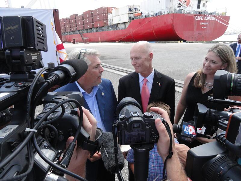 Gov. Scott talks to the media at the port