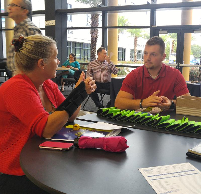 Joshua Holderby meets with area employers at an open house for Suncoast Technical College in Sarasota.